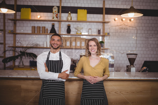 Portrait of smiling young wait staff standing against counter Stock photo © wavebreak_media