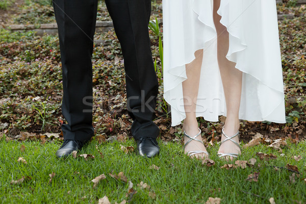 Low section of newlywed couple standing on field Stock photo © wavebreak_media