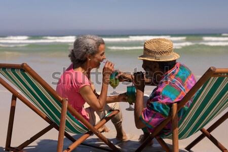 Couple relaxing while having a glass of drink Stock photo © wavebreak_media