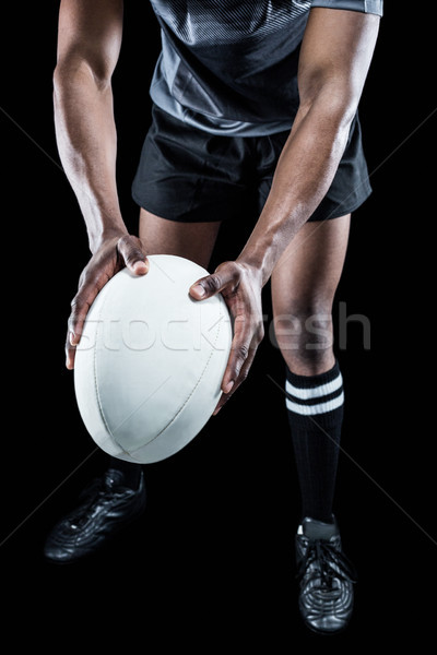 Low section of athlete holding rugby ball Stock photo © wavebreak_media