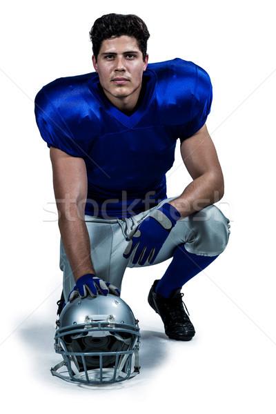 Portré amerikai futballista kéz sisak térdel Stock fotó © wavebreak_media