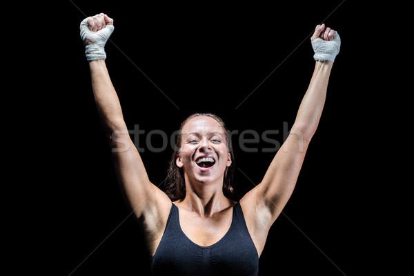 Boldog nyertes karok a magasban fekete siker női Stock fotó © wavebreak_media