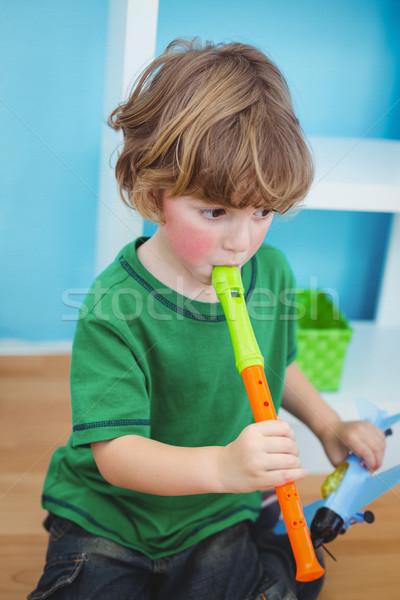 Küçük erkek oynama flüt büro mutlu Stok fotoğraf © wavebreak_media