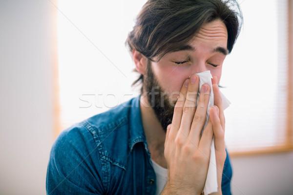 Malati uomo soffia il naso home soggiorno divano Foto d'archivio © wavebreak_media