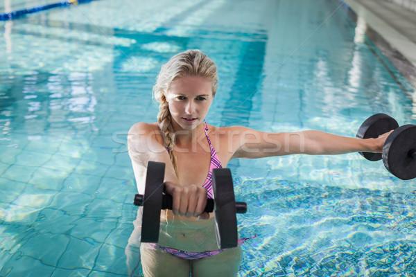 Haltères piscine femme eau Photo stock © wavebreak_media