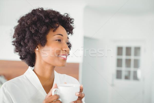 Jolie femme bain robe potable café cuisine Photo stock © wavebreak_media