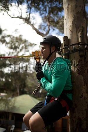 Little girl wearing helmet trying to fix her harness Stock photo © wavebreak_media