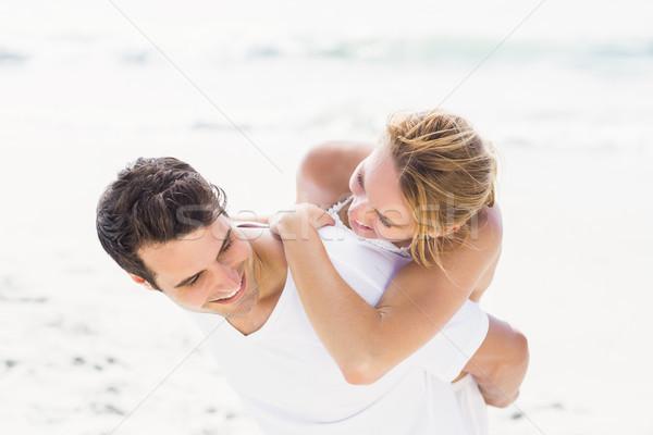 Man giving a piggy back to woman on the beach Stock photo © wavebreak_media