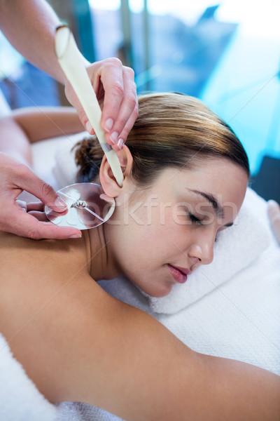 Mulher ouvido vela tratamento estância termal hotel Foto stock © wavebreak_media