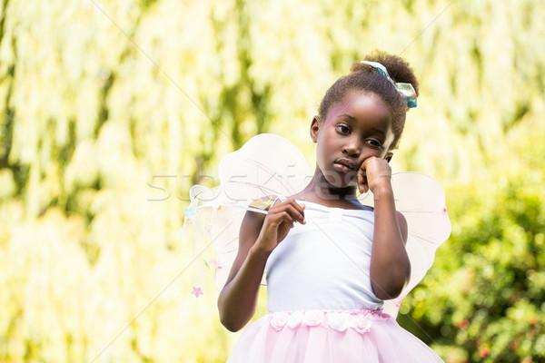 Bonitinho menina posando fadas vestir Foto stock © wavebreak_media