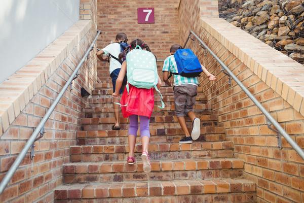 три школы дети скалолазания кирпичных лестницы Сток-фото © wavebreak_media