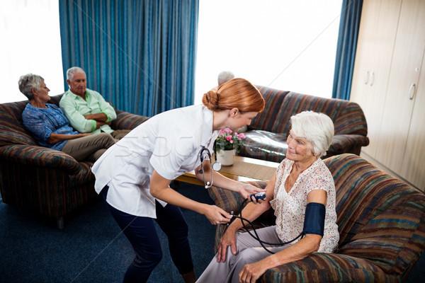 Nurse taking care of pensioner  Stock photo © wavebreak_media