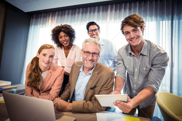 Portrait of business people smiling while having discussion over Stock photo © wavebreak_media