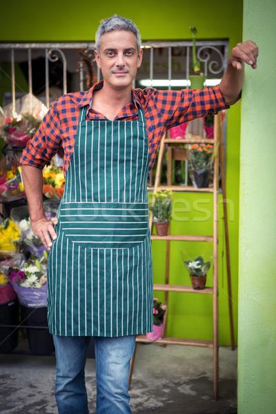 Male florist with hands on hip at flower shop Stock photo © wavebreak_media