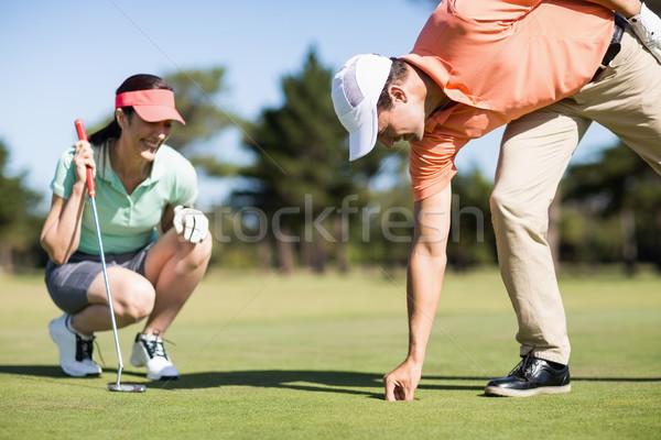 человека мяч для гольфа дыра женщину области Сток-фото © wavebreak_media