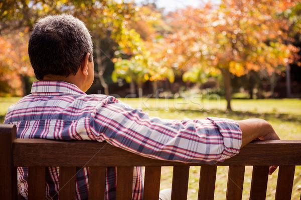 âgées homme séance seuls banc Photo stock © wavebreak_media