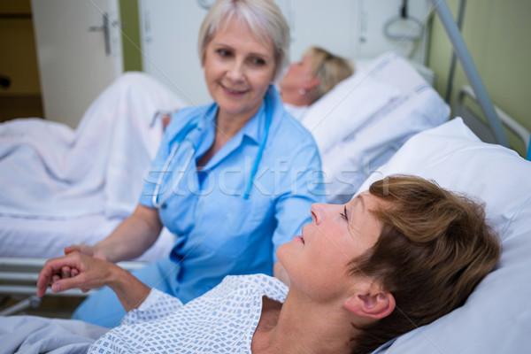 Nurse examining patients pulse  Stock photo © wavebreak_media