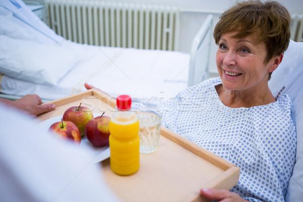 Nurse serving a breakfast to patient Stock photo © wavebreak_media