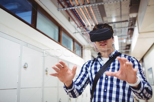 Student using virtual reality headset in locker room Stock photo © wavebreak_media