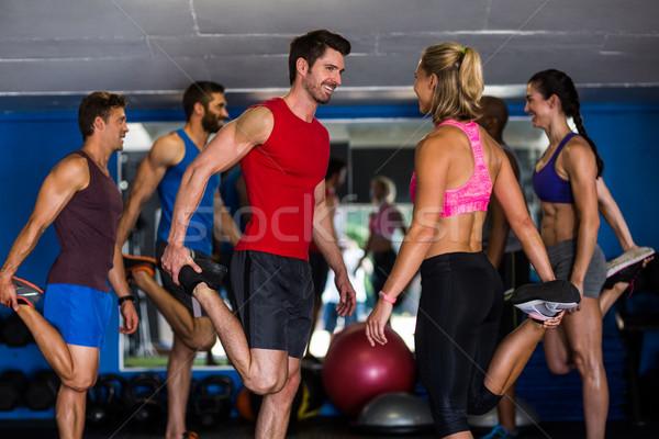 Gülen ayakta bir bacak spor salonu Stok fotoğraf © wavebreak_media