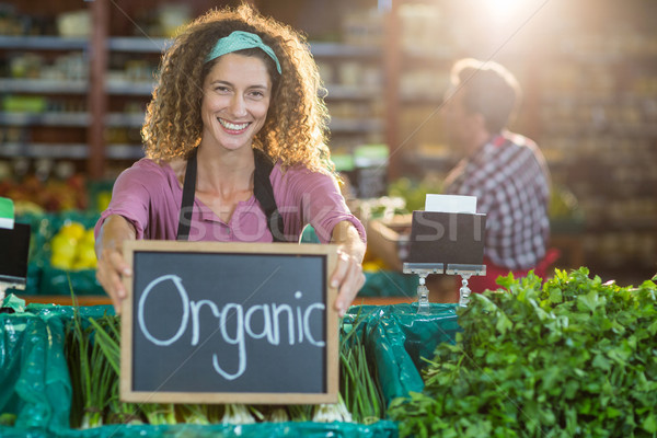 Smiling staff holding organic sign board in organic section Stock photo © wavebreak_media