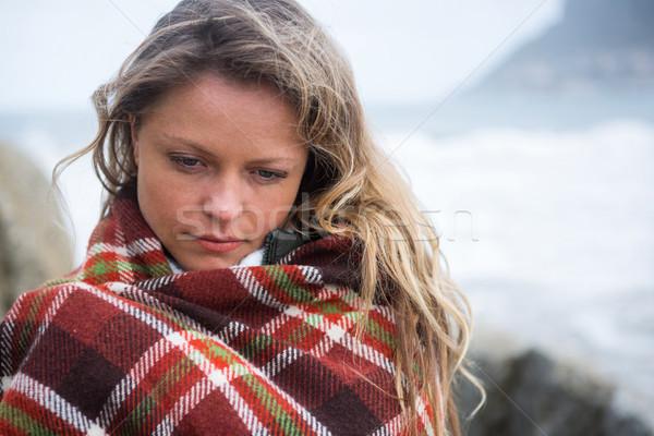 Thoughtful woman wrapped in shawl Stock photo © wavebreak_media
