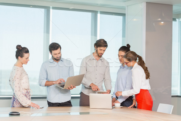 Business executives discussing with each other in conference room Stock photo © wavebreak_media