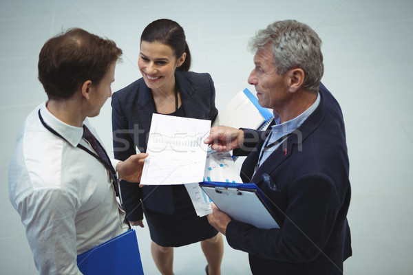 Businesspeople having discussion over document Stock photo © wavebreak_media