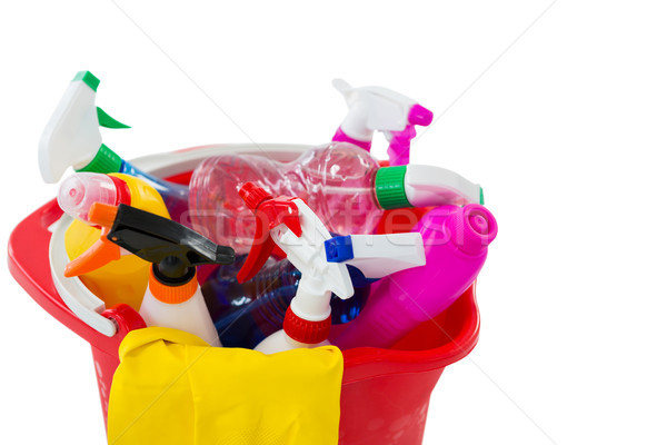High angle view of cleaning spary and bottles in bucket Stock photo © wavebreak_media