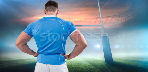 Composite image of rugby player with hands on hips Stock photo © wavebreak_media