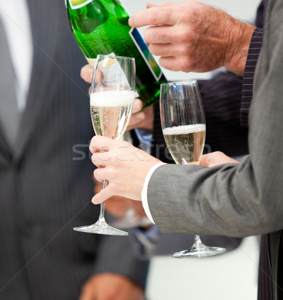 Close-up of a business person serving Champagne Stock photo © wavebreak_media