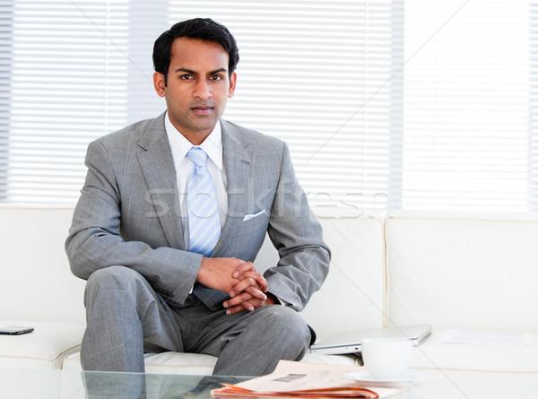 Self-assured businessman sitting on the sofa Stock photo © wavebreak_media