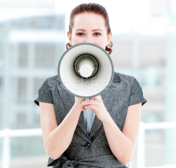 Angry businesswoman yelling through a megaphone Stock photo © wavebreak_media