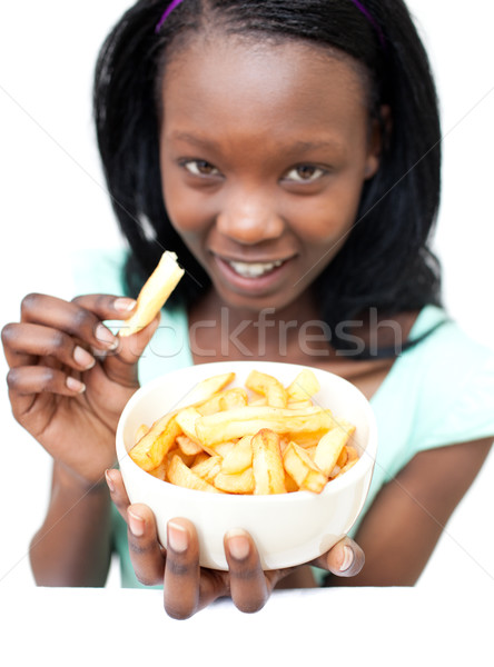 Attractive young woman eating fries Stock photo © wavebreak_media