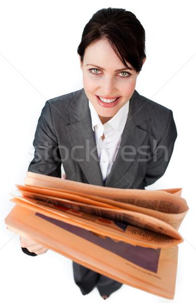 Assertive businesswoman reading a newspaper  Stock photo © wavebreak_media
