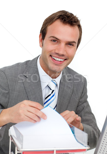 Confident young businessman studying a contract Stock photo © wavebreak_media