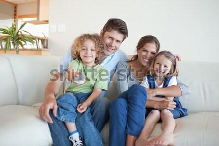 Boldog család tapsol gól kanapé lány technológia Stock fotó © wavebreak_media