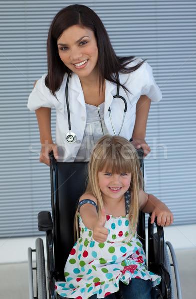 молодые женщины врач улыбаясь девушки коляске Сток-фото © wavebreak_media
