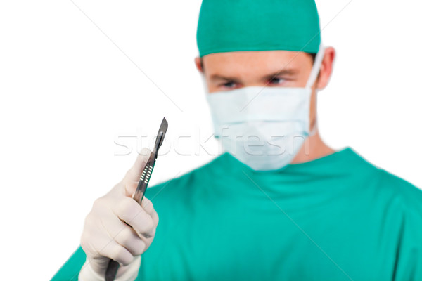 Self-assured surgeon holding a scalpel  Stock photo © wavebreak_media
