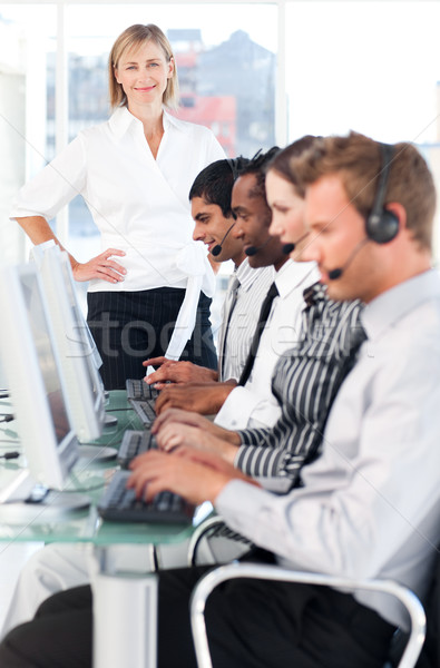 Female leader managing her concentrated team in a call center Stock photo © wavebreak_media