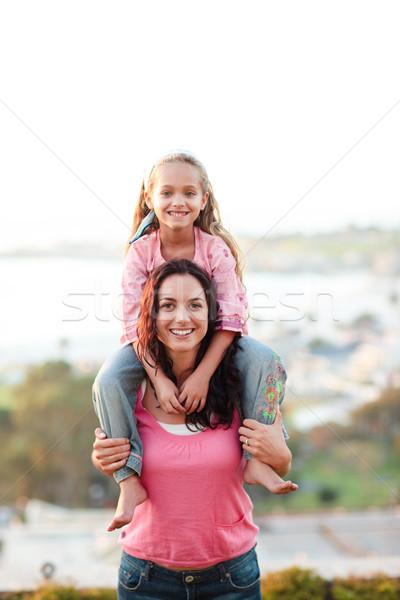 Mother giving her daughter piggyback Stock photo © wavebreak_media
