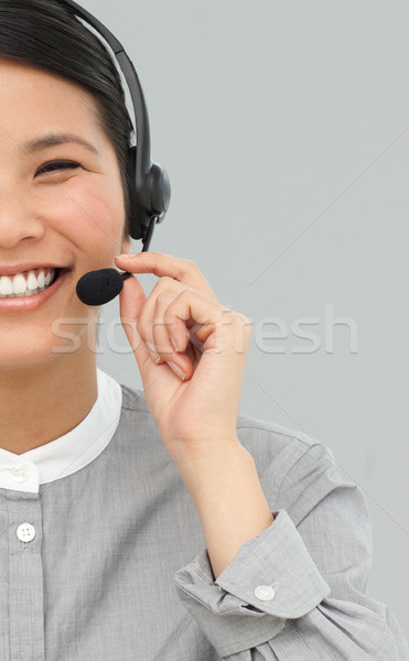 Smiling businesswoman with headset on  Stock photo © wavebreak_media