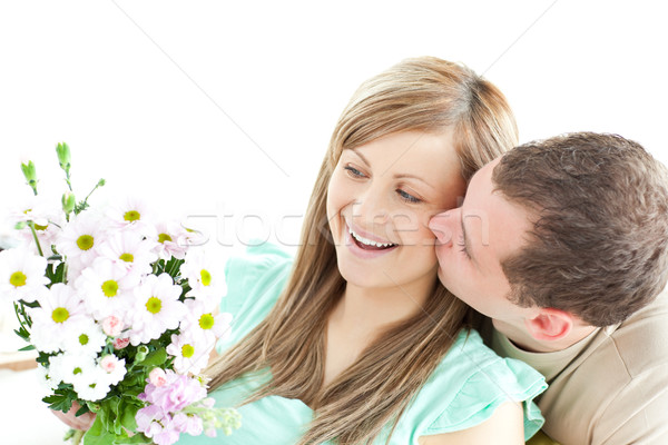 Enamored man giving a bouquet to his girlfriend  Stock photo © wavebreak_media
