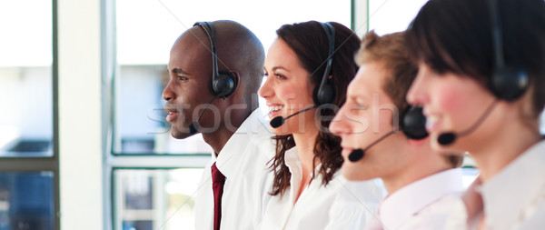 Portrait of a relaxed sale representative team at work in a office Stock photo © wavebreak_media