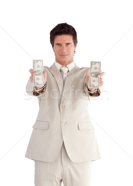 Self-assured Businessman holding Dollars against a white background Stock photo © wavebreak_media