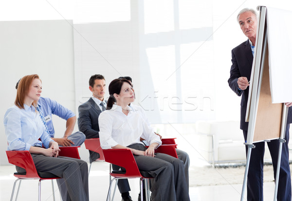 Multi-ethnic business people at a seminar in the office Stock photo © wavebreak_media