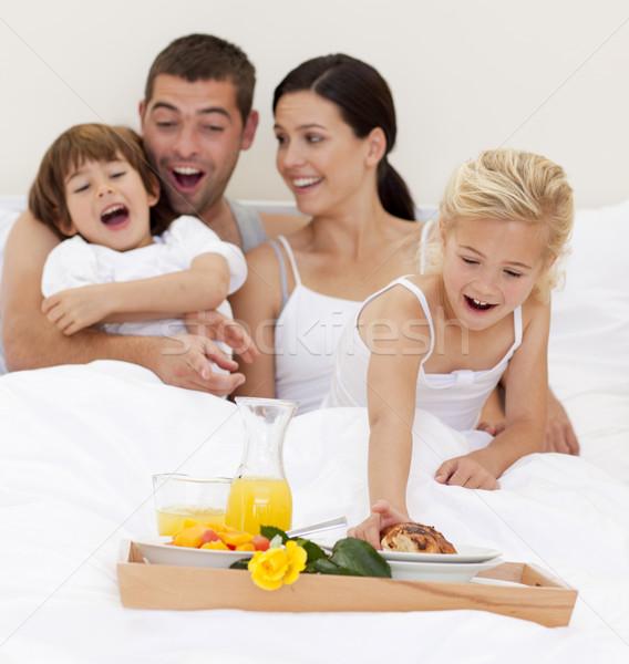 Family having nutritive breakfast  in bed in the morning Stock photo © wavebreak_media