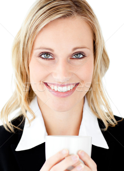 Radiant businesswoman holding a cup smiling at the camera against white background Stock photo © wavebreak_media