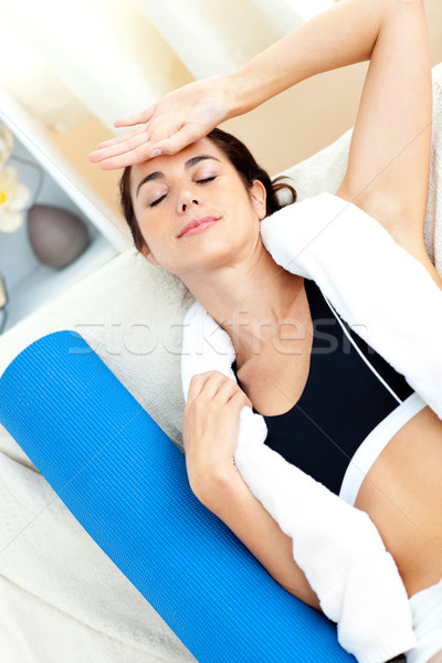 Tired hispanic woman sitting on the sofa after working out at home Stock photo © wavebreak_media