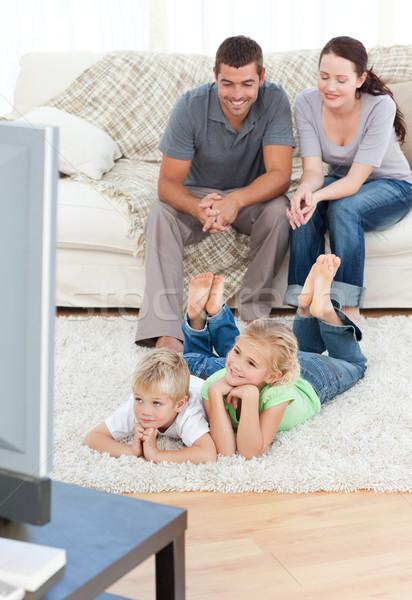 Imádnivaló testvérek tv nézés szülők padló nappali Stock fotó © wavebreak_media